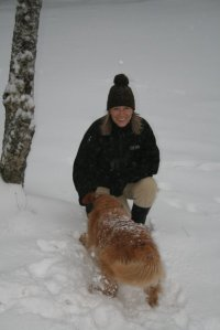 Me and Bailey playing in the snow during her last winter.