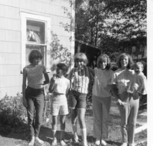At 15, I'm in the middle with the striped shirt.
